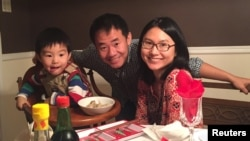 Xiyue Wang, a naturalized American citizen from China, arrested in Iran last August while researching Persian history for his doctoral thesis at Princeton University, is shown with his wife and son in this family photo, undated