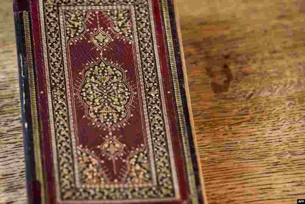 "A picture taken on January 16, 2020 at the apartment of Dutch art crime investigator Arthur Brand in Amsterdam shows a rare 15th-century book of poems by Shams-ud-din Muhammad Hafiz's ""Divan"". - A stolen 15th-century book by the famed Persian poet Hafez h"