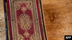 """A picture taken on January 16, 2020 at the apartment of Dutch art crime investigator Arthur Brand in Amsterdam shows a rare 15th-century book of poems by Shams-ud-din Muhammad Hafiz's """"Divan"""". - A stolen 15th-century book by the famed Persian poet Hafez h"""