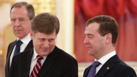 Russian President Dmitry Medvedev (right), Foreign Minister Sergei Lavrov (left), and U.S. Ambassador Michael McFaul at the Kremlin in February