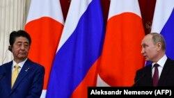 Президент Росії Володимир Путін і прем'єр-міністр Японії Сіндзо Абе