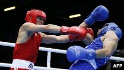 Қазақ боксшысы Қанат Әбутәліповтің 56 кг салмақта 1/32 финалда жеңіске жеткен сәті. Лондон, 28 шілде 2012 жыл