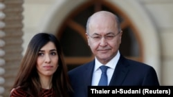 Iraqi President Barham Salih meets with Nobel Peace Prize laureate and Yazidi activist Nadia Murad at the Salam Palace in Baghdad on December 12, 2018.