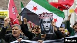 Pro-Islamist demonstrators, holding a Syrian opposition flag and a defaced poster of Russian President Vladimir Putin, shout slogans during an anti-Russian protest in Istanbul, Turkey, on November 27.