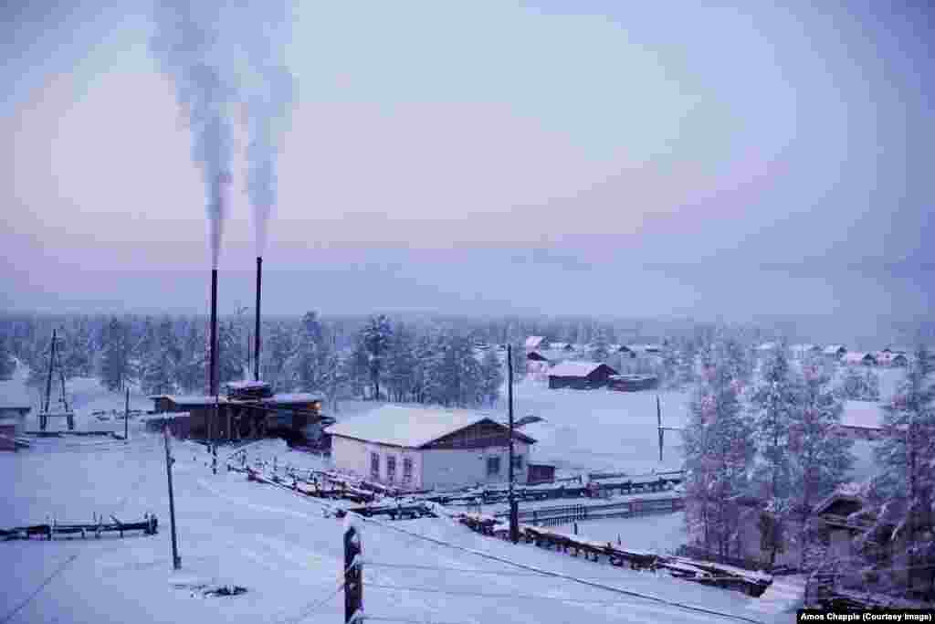 "The village of Oymyakon, with its heating plant chugging coal smoke into the freezing air. It was dubbed ""The Pole Of Cold"" after recording a temperature of minus 71.2 degrees Celsius in 1933. The record freeze was just a few degrees shy of the minus 78.5 C temperature of dry ice."