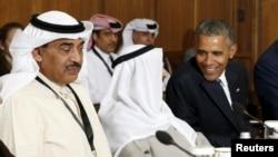 U.S. President Barack Obama talks with the emir of Kuwait , Sheikh Sabah Al-Ahmad Al-Jaber Al-Sabah, as he hosts a summit at Camp David in Maryland on May 14.