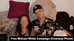 File photo:US citizen imprisoned in iran, michael white, seen with his mother