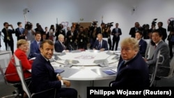 French President Emmanuel Macron, U.S. President Donald Trump and other Western leaders meeting in France on August 25, 2019.