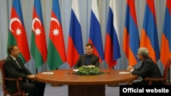 Russian President Dmitry Medvedev flanked by the presidents of Azerbaijan and Armenia -- Ilham Aliyev on the left and Serzh Sarkisian on the right -- at a previous tripartite meeting