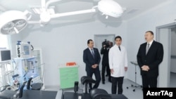 Prezident İlham Əliyev Astara Rayon Xəstəxanasının əsaslı təmirdən sonra açılışında (Arxiv).