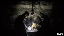 Men play chess during a power cut in Yalta, Crimea, in November.