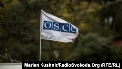 The OSCE flag is seen during a monitoring mission in Ukraine. (file photo)