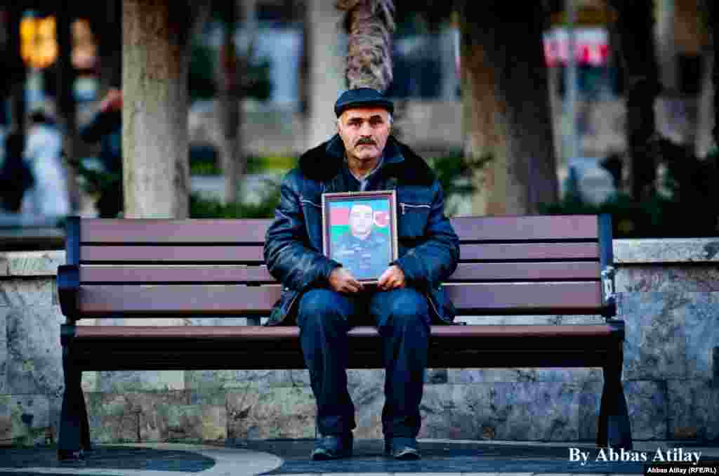 Hundreds of people demonstrated in the Azerbaijani capital, Baku, on January 13 to call atention to the deaths of young army conscripts. (RFE/RL)