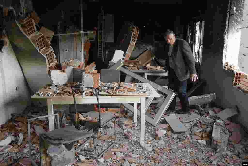 Ethnic Albanian Azem Ibrahimi visits his destroyed house in a neighborhood where a gunbattle took place between Macedonian police and an armed group in the town of Kumanovo.