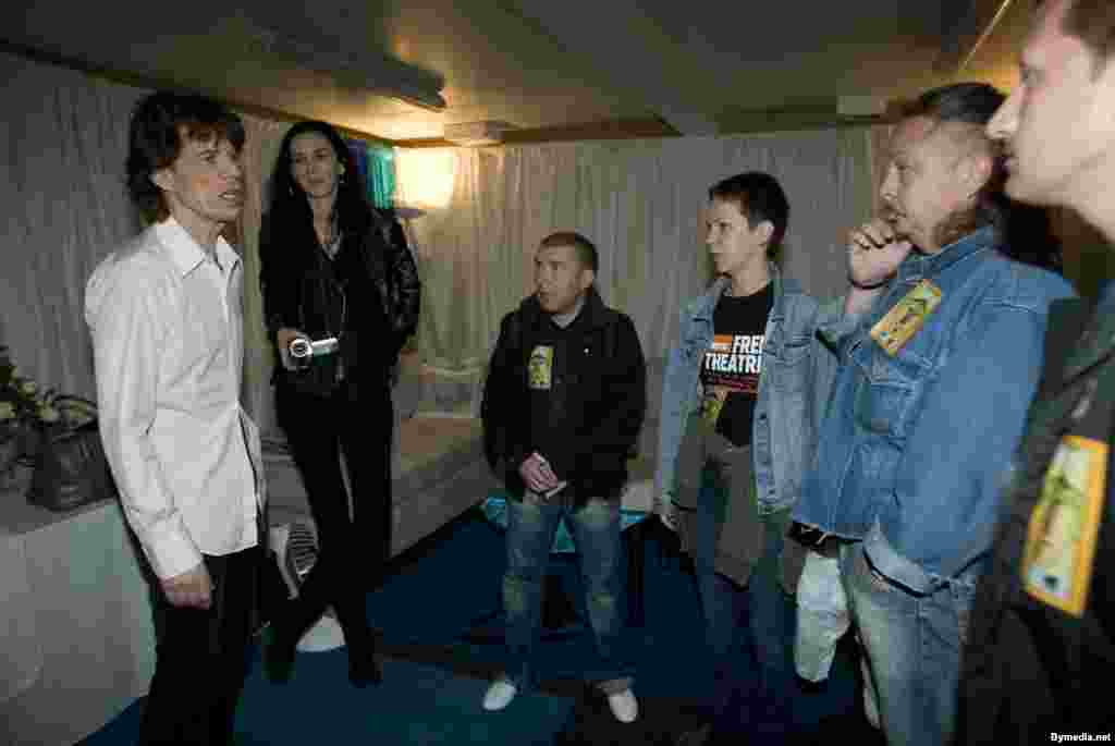 Representatives of the Belarus Free Theater group chat with Jagger in Warsaw in 2007. Jagger publicly supported the underground group's battle against Minsk's cultural censorship.