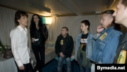 Mick Jagger (left) meets backstage with members of the Belarus Free Theater in Warsaw on July 26, 2007, shortly before the Rolling Stones performed for 60,000 fans.