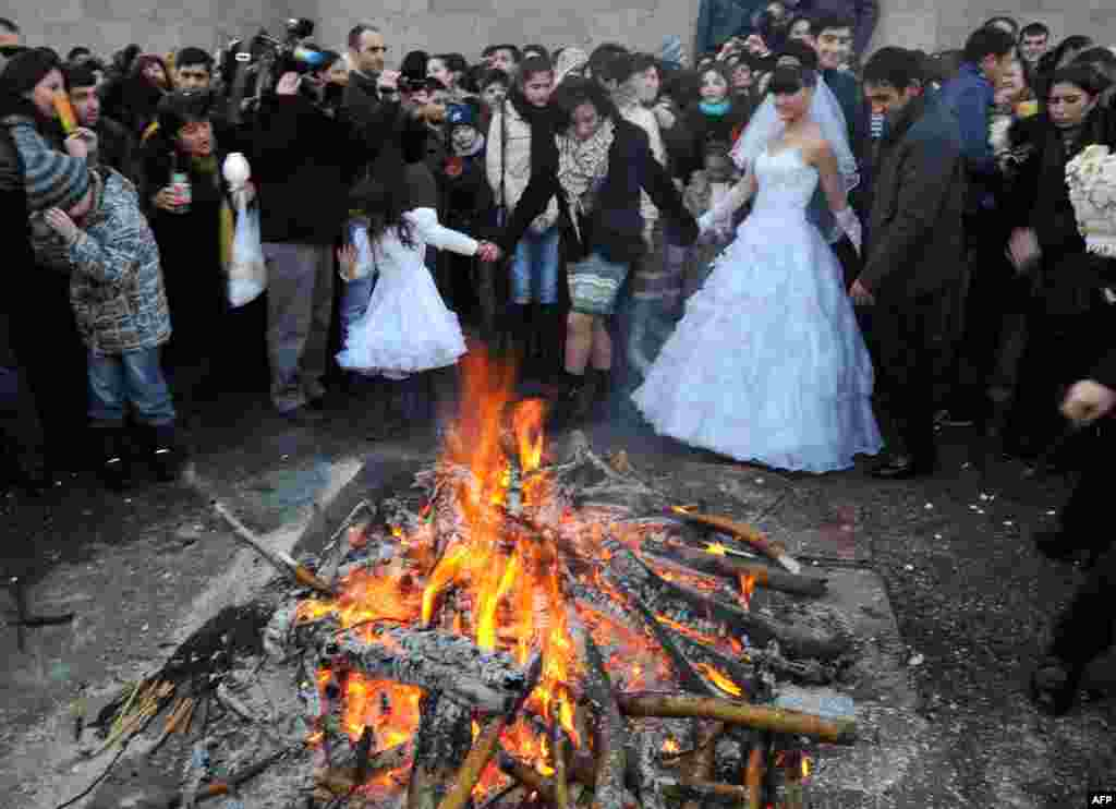 A wedding party crowds around a bonfire to mark Trndez, an ancient pagan festival now absorbed into the Christian calendar, in Yerevan, Armenia.3. (AFP/Karen Minasyan)