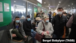 Kyrgyz migrant workers wait at Sheremetyevo International Airport ahead of a repatriation flight from Moscow to Bishkek on May 17.