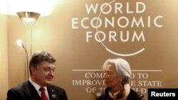 Директор-розпорядник МВФ Крістін Лаґард і президент України Петро Порошенко на щорічних зборах Всесвітнього економічного форуму, Швейцарія, січень 2015 року