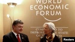 Директор-распорядитель МВФ Кристин Лагард и президент Украины Петр Порошенко