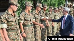 Nagorno-Karabakh - Armenian President Serzh Sarkisian greets soldiers serving near the Line of Contact with Azerbaijan, 22Jun2016.