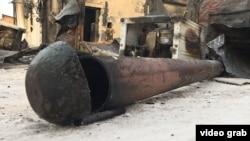 Обгоревшая печная труба. На месте пожара в Астане, 4 февраля 2019 года.