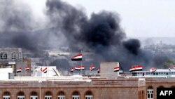 Black smoke ascends in the vicinity of the Interior Ministry Building in the Yemeni capital, Sanaa