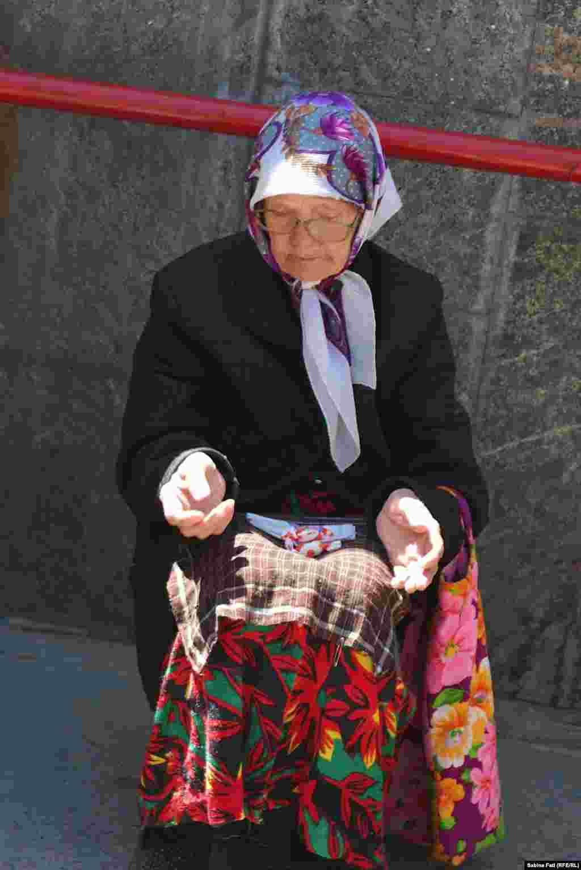 A woman begs in Almaty, Kazakhstan. July 21, 2014.