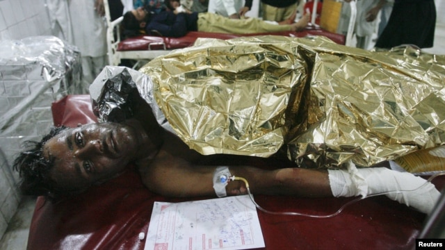 A man injured in the bomb blast in Nowshera awaits treatment at a hospital in Peshawar.