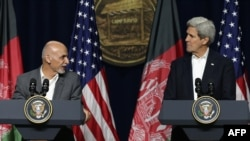 Afghanistan President Ashraf Ghani (L) and U.S. Secretary of State John Kerry hold a news conference after a day of talks at Camp David on March 23.