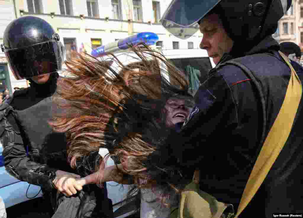 Russian police detain an opposition protester during a May Day rally in St. Petersburg on May 1. (Reuters/Igor Russak)