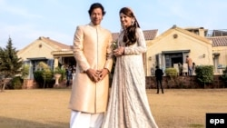 Imran Khan poses for a photo with his bride Reham Khan in January.