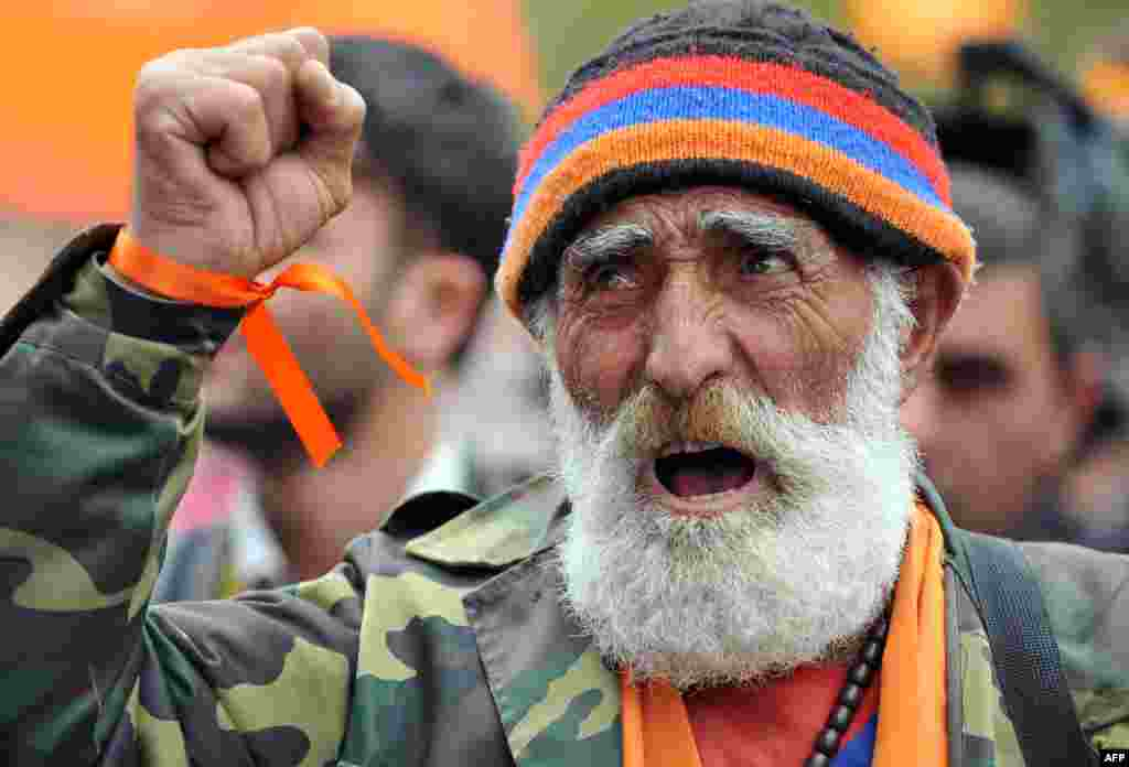 A supporter of Armenian opposition leader Raffi Hovannisian shouts during an inauguration-day rally against President Serzh Sarkisian's victory in February elections in Yerevan. (AFP/Karen Minasyan)