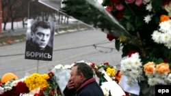 A man reacts at the site where veteran Russian opposition leader Boris Nemtsov was shot dead in central Moscow.