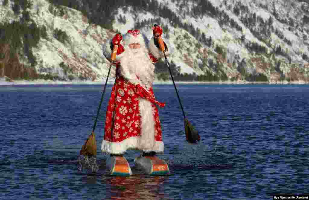 Nikolai Vasilyev, 64, dressed as Father Frost, the Russian equivalent of Santa Claus, water-skis along the Yenisei River outside the Siberian city of Krasnoyarsk. (Reuters/Ilya Naymushin)