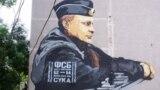 Граффити телеграм-партии «Суверенный Крым» на мурале с изображением президента России Владимира Путина
