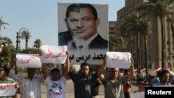 Тахрир алаңында Мұхаммед Мурсиге қарсы наразылық танытып тұрғандар. Каир, 28 маусым 2013 жыл.
