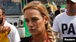 Лилиан Тинтори, жена Леопольдо Лопеса – и бывшая чемпионка Венесуэлы по океанскому сёрфингу