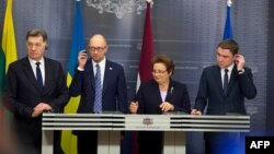 Lithuanian Prime Minister Algirdas Butkevicius (left to right), Ukranian Prime Minister Arseniy Yatsenyuk, Latvian Prime Minister Laimdota Straujuma, and Estonian Prime Minister Taavi Roivas speak to the press after their meeting in Riga on November 5.