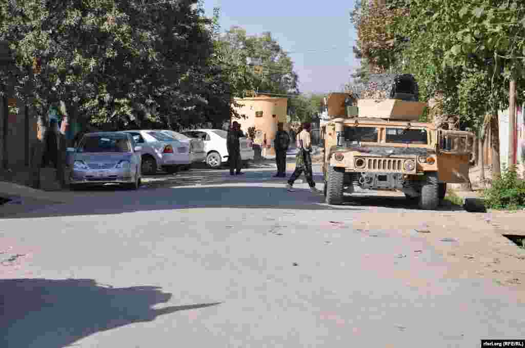 Government forces are out in the streets of Kunduz to show their control over the city on October 5.