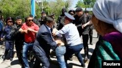 Kazakh riot police in Almaty detain demonstrators during a protest against proposed land reforms, in May 2016.
