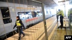 Мальме вокзалындағы күзет.