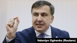 Mikheil Saakashvili addresses the media inside a court building in Kyiv on January 3.