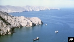 "This file photo from around 1980 shows the Strait of Hormuz, a crucial 20-mile-wide sea link between the Persian Gulf oil-exporting nations and shipping lanes to oil-importing nations. Sources say ""scores of vessels"" have been stranded in Iraqui"