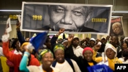 South Africans arriving at the Johannesburg stadium before the memorial service for Nelson Mandela on December 10.