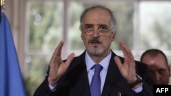 Syrian Ambassador to the United Nations (UN) and head of the government delegation to the peace talks Bashar al-Jaafari gestures as he speaks during a press conference in Geneva on March 16.