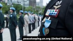 Одна з медалей ООН за участь в операції з підтримання миру