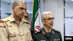 Chief of Staff for the Iranian Armed Forces Major General Mohammad Baqeri (R) and his Iraqi counterpart Major General Othman al-Ghanmi (L) meet in Tehran on September 27, 2017. (Photo by ISNA)