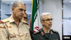 Chief of Staff of the Iranian Armed Forces Major General Mohammad Baqeri (R) and his Iraqi counterpart Major General Othman al-Ghanmi (L) meet in Tehran on September 27, 2017. (Photo by ISNA)