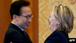South Korean President Lee Myung-Bak and Secretary of State Hillary Clinton greet each other at their meeting in Seoul on May 26.